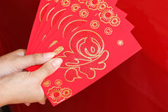 Happy chinese new year, woman hand holding red envelope Royalty Free Stock Photos