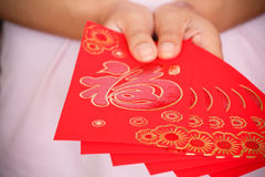 Happy chinese new year, woman hand holding red envelope Royalty Free Stock Image