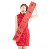 Happy chinese new year.  woman showing the red couplets Royalty Free Stock Photos
