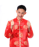 Happy Chinese new year.Young Asian man with gesture of congratul Royalty Free Stock Image