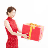 Happy chinese new year. young woman holding gift box Stock Photography