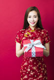 Happy chinese new year.young woman holding gift box Royalty Free Stock Images