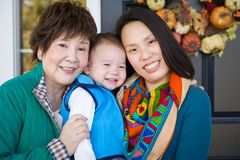 Happy Chinese Senior Adult Grandmother with Her Daughter and Grandson royalty free stock images