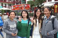 Happy students are shopping in West Street,Yangshuo,China. Portrait of female Chinese students who are happy in West Street, the famous oldest street in Yangshuo Stock Photos