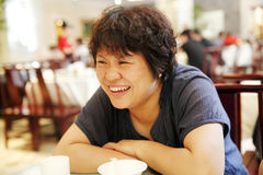 Happy Chinese woman. In a restaurant Royalty Free Stock Photo