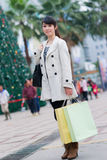 Happy Chinese woman go shopping Royalty Free Stock Image