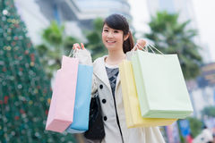 Happy Chinese woman go shopping Royalty Free Stock Photography