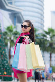 Happy Chinese woman go shopping Stock Image