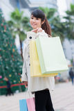 Happy Chinese woman go shopping Royalty Free Stock Photo