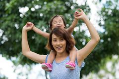 Happy Chinese woman and her daughter Stock Image
