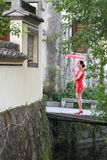Happy Chinese woman in red cheongsam tour at ancient town Royalty Free Stock Image