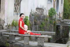 Happy Chinese woman in red cheongsam tour at ancient town Stock Photography