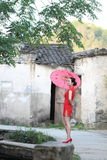 Happy Chinese woman in red cheongsam tour at ancient town Stock Image