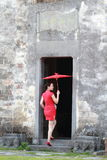 Happy Chinese woman in red cheongsam tour at ancient town Royalty Free Stock Photo