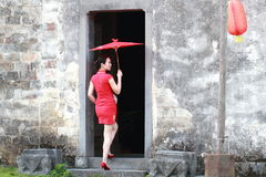 Happy Chinese woman in red cheongsam tour at ancient town Royalty Free Stock Photography