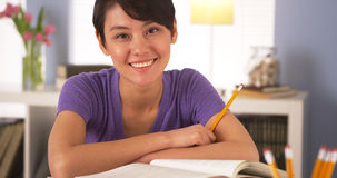 Happy Chinese woman smiling with books Stock Photos