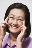 Happy Chinese Woman Trying On Glasses Royalty Free Stock Photo