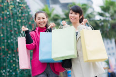 Happy Chinese women go shopping Royalty Free Stock Image