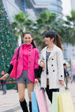 Happy Chinese women go shopping Royalty Free Stock Photography