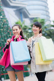 Happy Chinese women go shopping Stock Photography