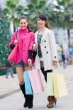 Happy Chinese women go shopping Stock Photos