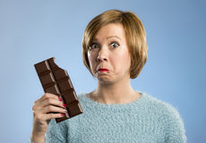 Happy chocolate addict woman holding big bar mouth stained and crazy excited face expression Stock Images