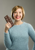 Happy chocolate addict woman holding big bar mouth stained and crazy excited face expression Royalty Free Stock Image