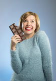 Happy chocolate addict woman holding big bar mouth stained and crazy excited face expression Royalty Free Stock Photography