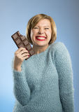 Happy chocolate addict woman holding big bar mouth stained and crazy excited face expression Royalty Free Stock Images