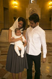 Happy christian family in the Armenian apostolic C. Happy christian family with cut baby on hand in the Armenian apostolic Church Royalty Free Stock Image