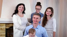 Happy christian family of five posing together for family portrait, first photosession of child stock video
