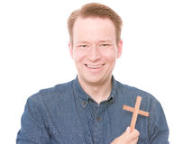 Happy christian. Young smiling man holding a cross for your christian, catholic and protestant concepts - isolated on white and retouched royalty free stock photography