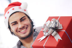 Happy christmas. Present christmas and happy man Royalty Free Stock Photography