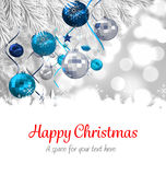 Happy Christmas against christmas decorations. Hanging from branch Royalty Free Stock Photo