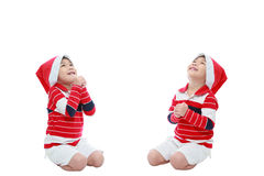 Happy christmas asian boy in santa hat praying. Isolated on whit Royalty Free Stock Photography