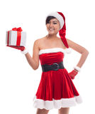 Happy Christmas asian girl holding gift with smiling. Royalty Free Stock Image