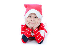 Happy christmas boy laying and smiling Royalty Free Stock Image