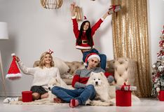 Happy christmas celebrating of young people with dogs and gifts stock photo