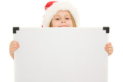 Happy Christmas child with the board Royalty Free Stock Photos