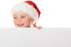 Happy Christmas child with the board Stock Photography