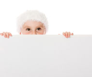 Happy Christmas child with the board Royalty Free Stock Photography