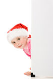 Happy Christmas child with the board Stock Photos