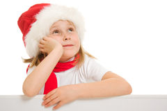 Happy Christmas child with the board looking up Stock Photography