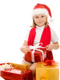 Happy Christmas child with gifts in the boxes Royalty Free Stock Image
