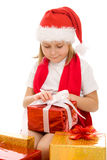 Happy Christmas child with gifts in the boxes Royalty Free Stock Photos
