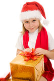Happy Christmas child with gifts in the boxes Stock Image