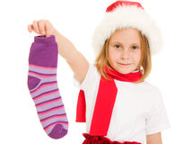 Happy Christmas child holding a colored sock Royalty Free Stock Photography