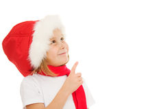 Happy Christmas child points his finger upward Stock Photography