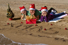 Happy christmas children  on beach Stock Photo