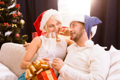 Happy Christmas couple celebrating New Year Stock Images